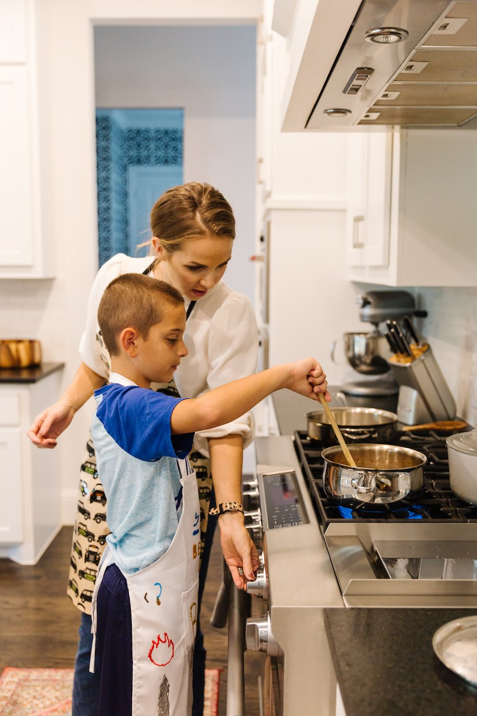 Cooking with Kids - mom and B in the kitchen at the stove