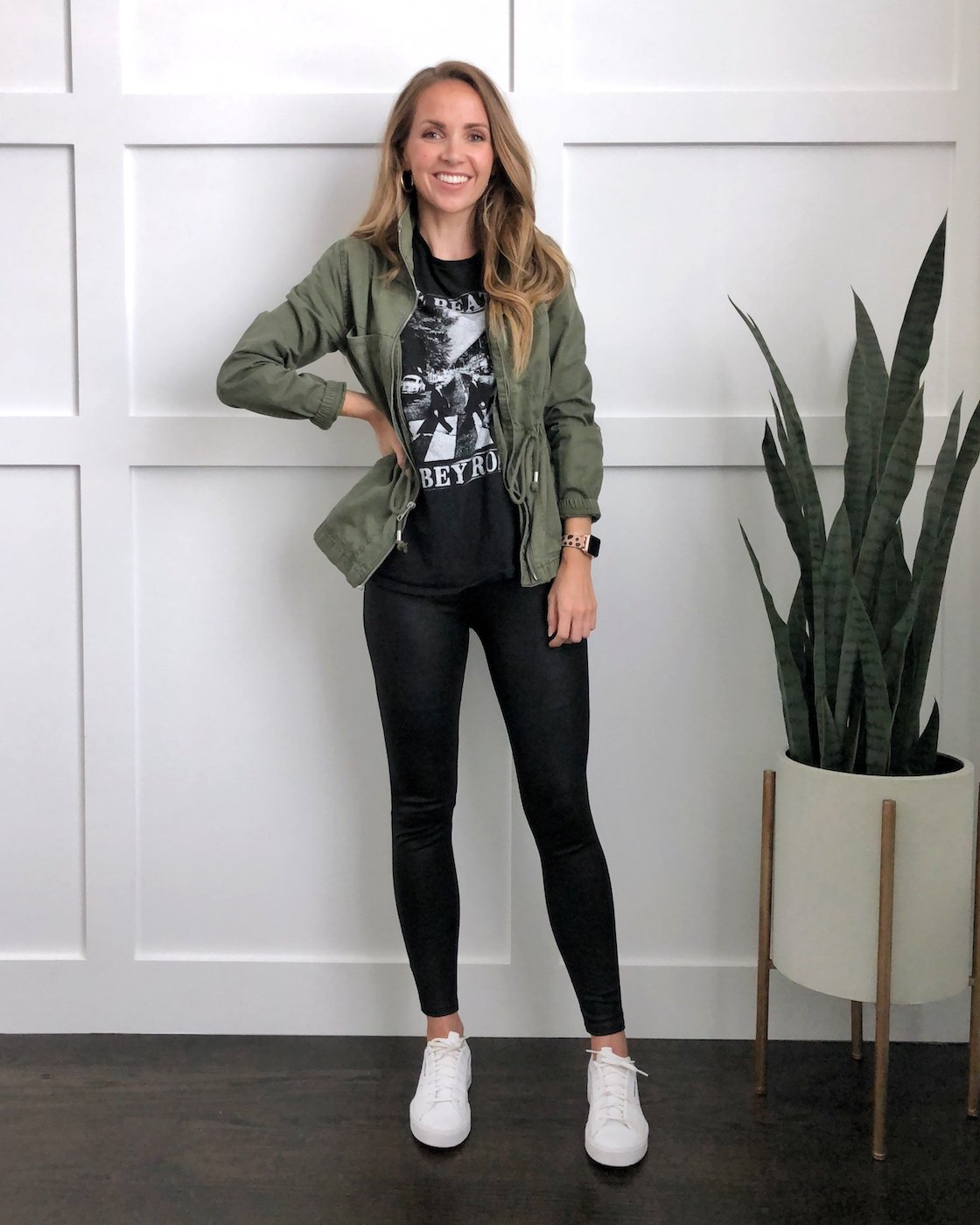 olive jacket with leather leggings and graphic tee