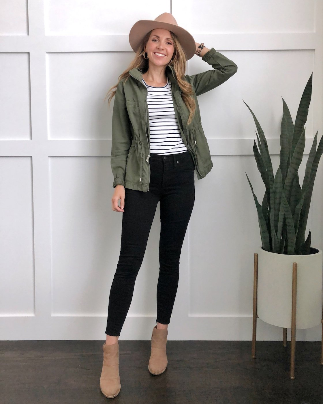 olive jacket with striped tee and ankle boots