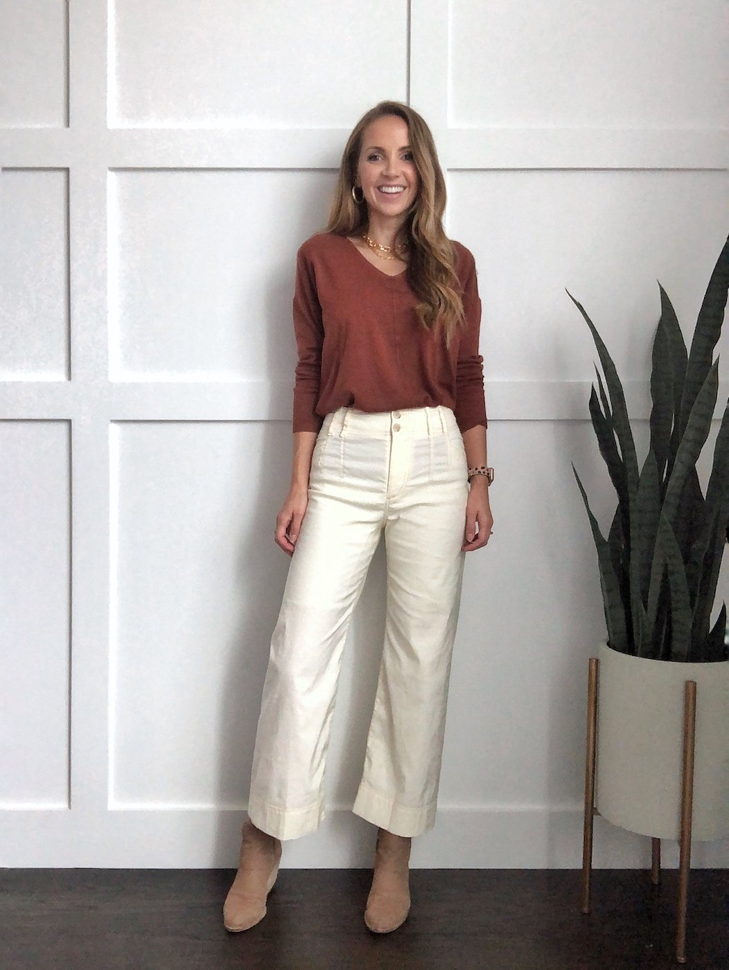 Winter whites outfit: wide leg pants with rust sweater