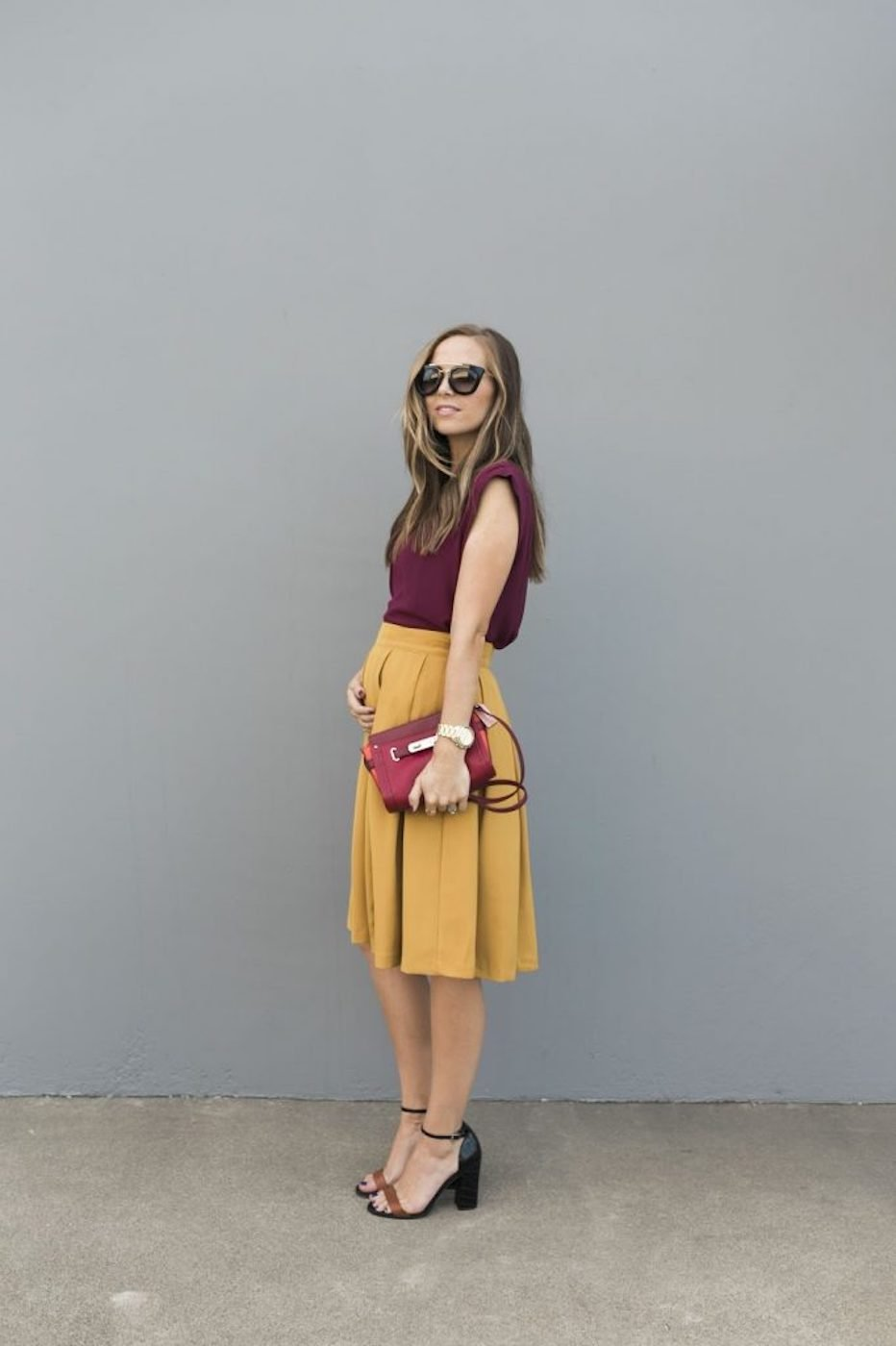 burgundy top and mustard skirt