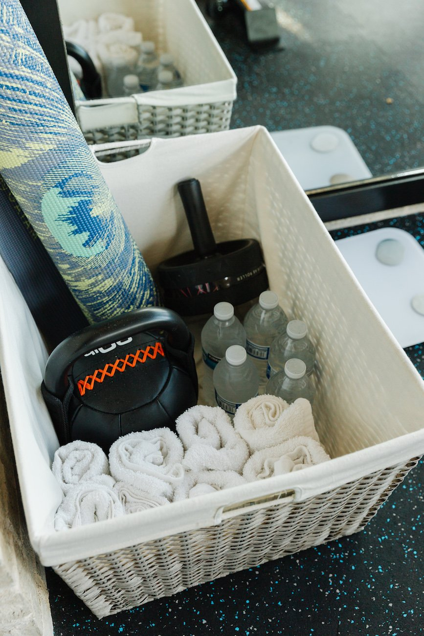 storage basket with yoga mat and water and towels