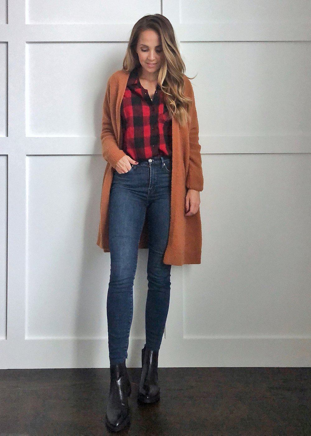 plaid shirt under a rust cardigan
