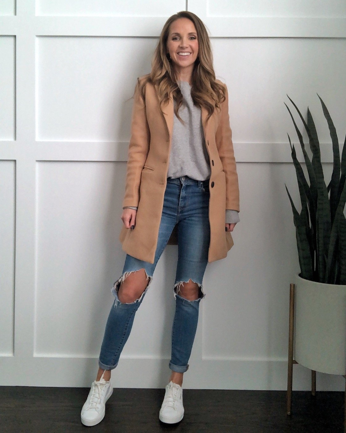 camel coat outfit with jeans and gray sweatshirt