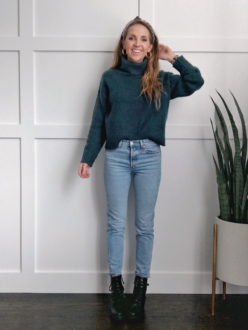 combat boots outfits - mom jeans and sweater