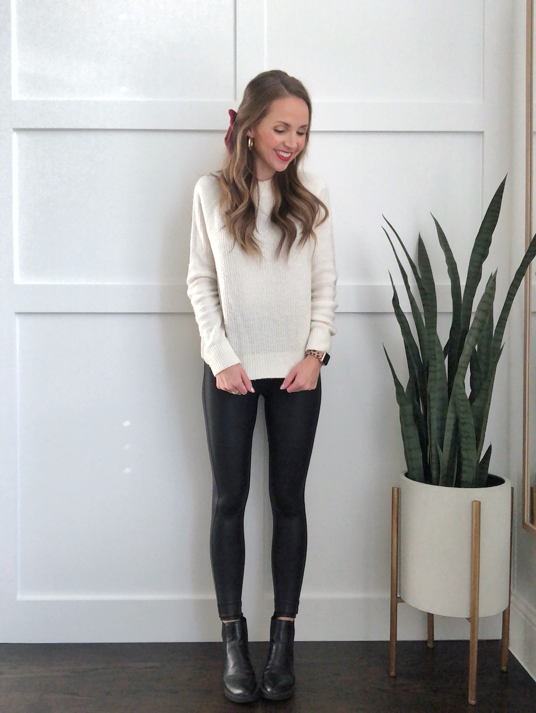 leather leggings and white sweater
