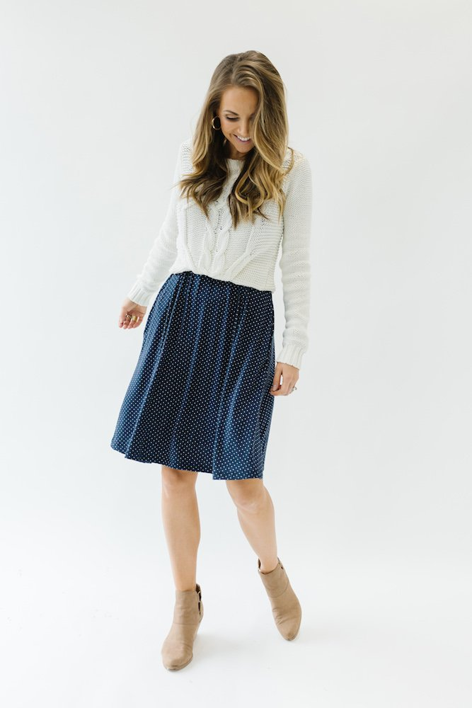 merrick white collection dress with sweater over the top
