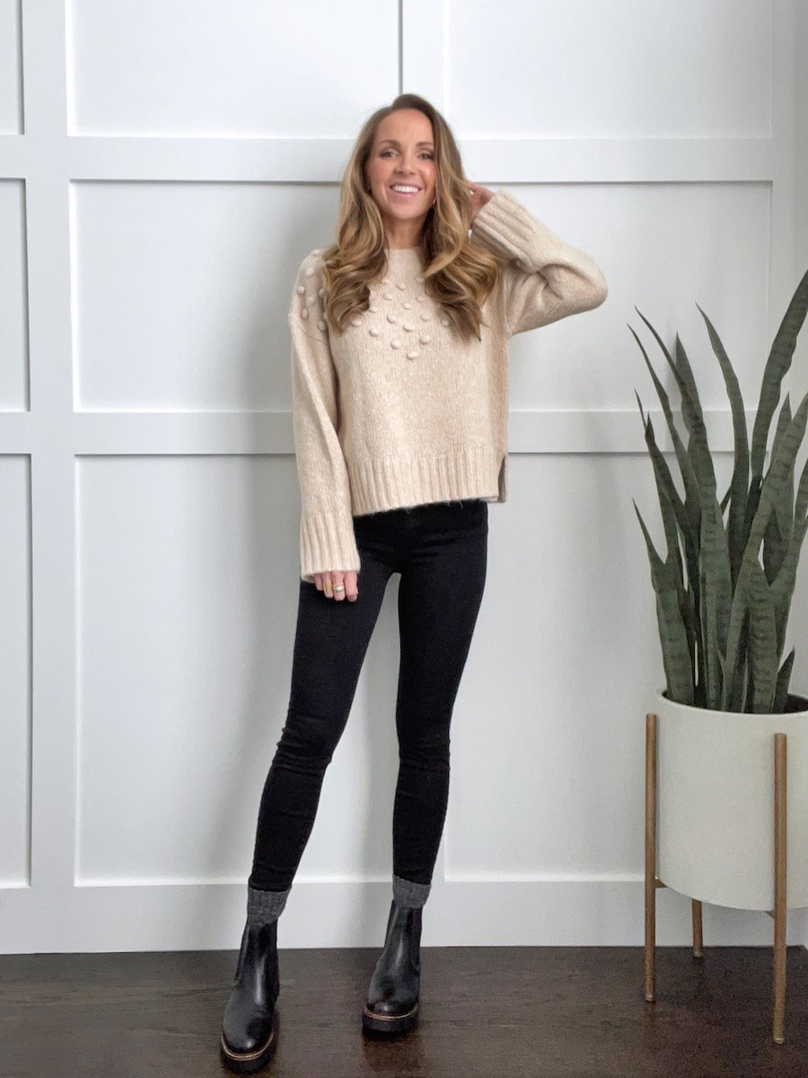 sweater with black jeans and black chelsea boots outfit