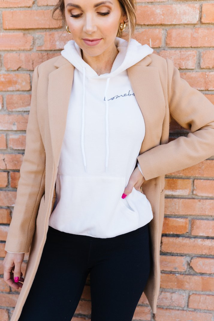 white hoodie with tan coat