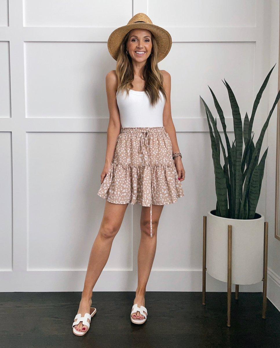 white swimsuit and mini skirt