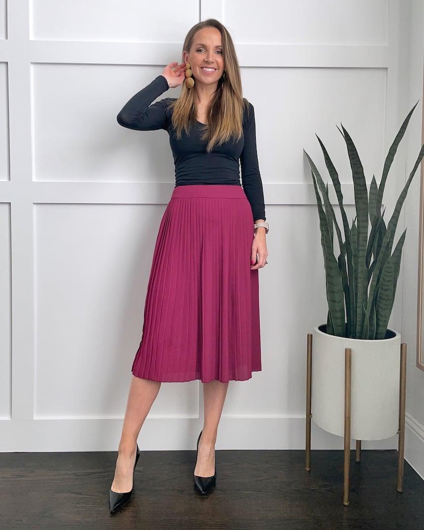 pink midi skirt with black bodysuit