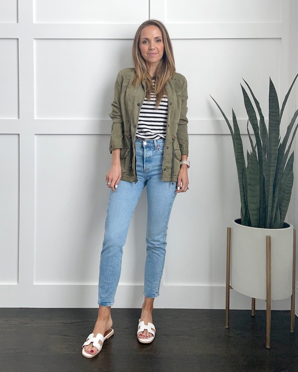 striped tees with light wash jeans and olive jacket