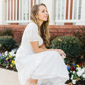 white eyelet dress and braided heeled sandals