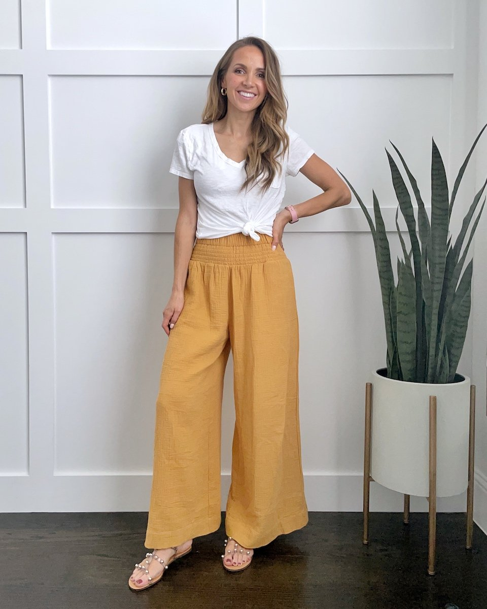 yellow pants and white knotted tee