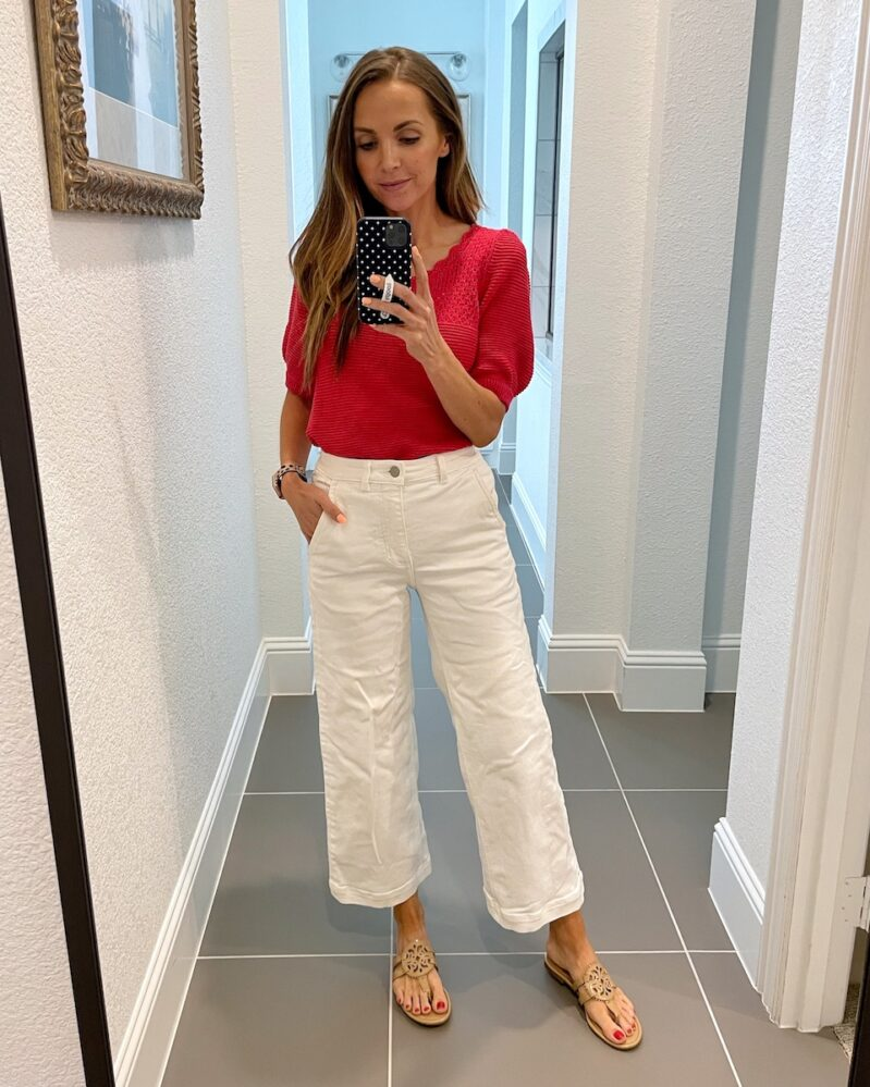 white pants and red sweater