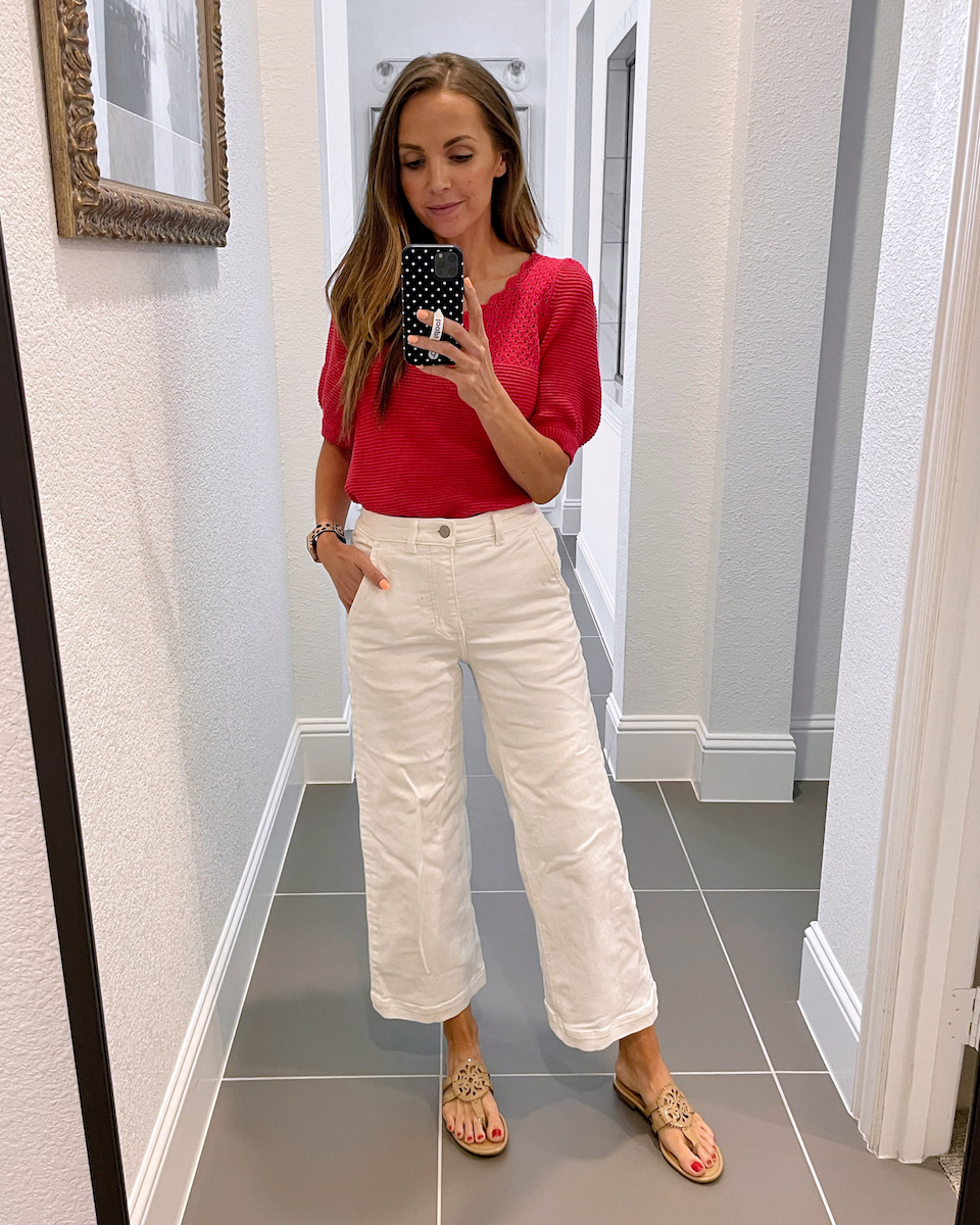 red short sleeve sweater and white pants