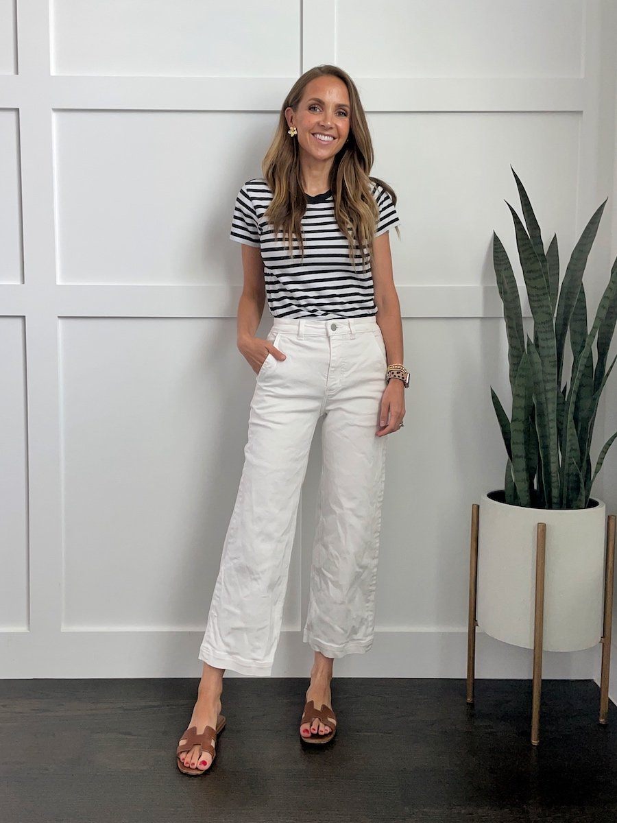 white wide leg jeans and striped tee with gold earrings