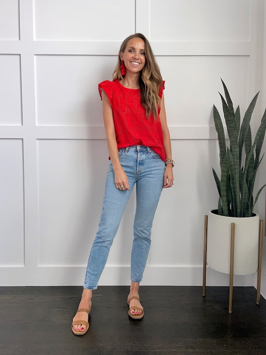 red eyelet top with red earrings