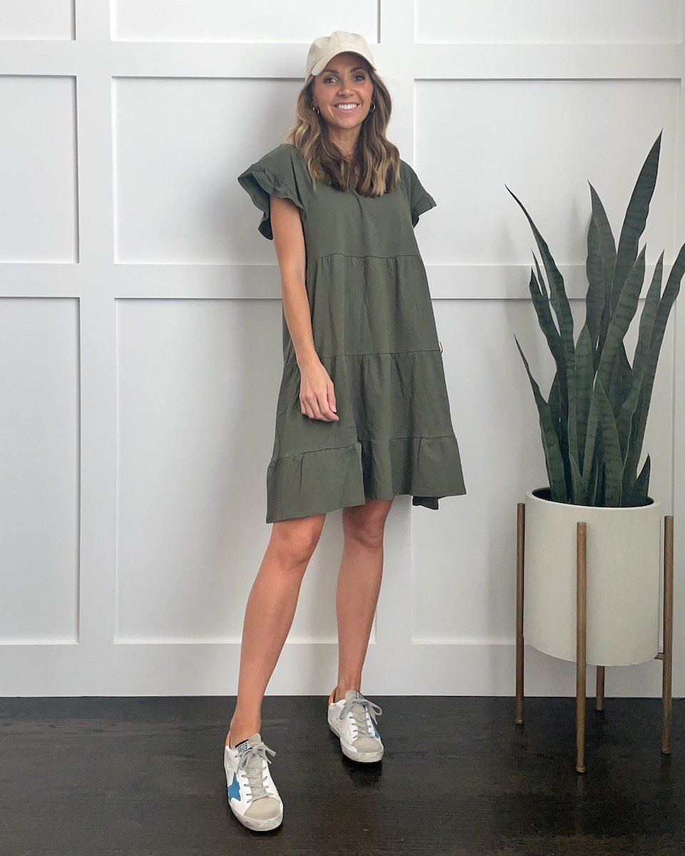how to wear a baseball cap with an olive dress
