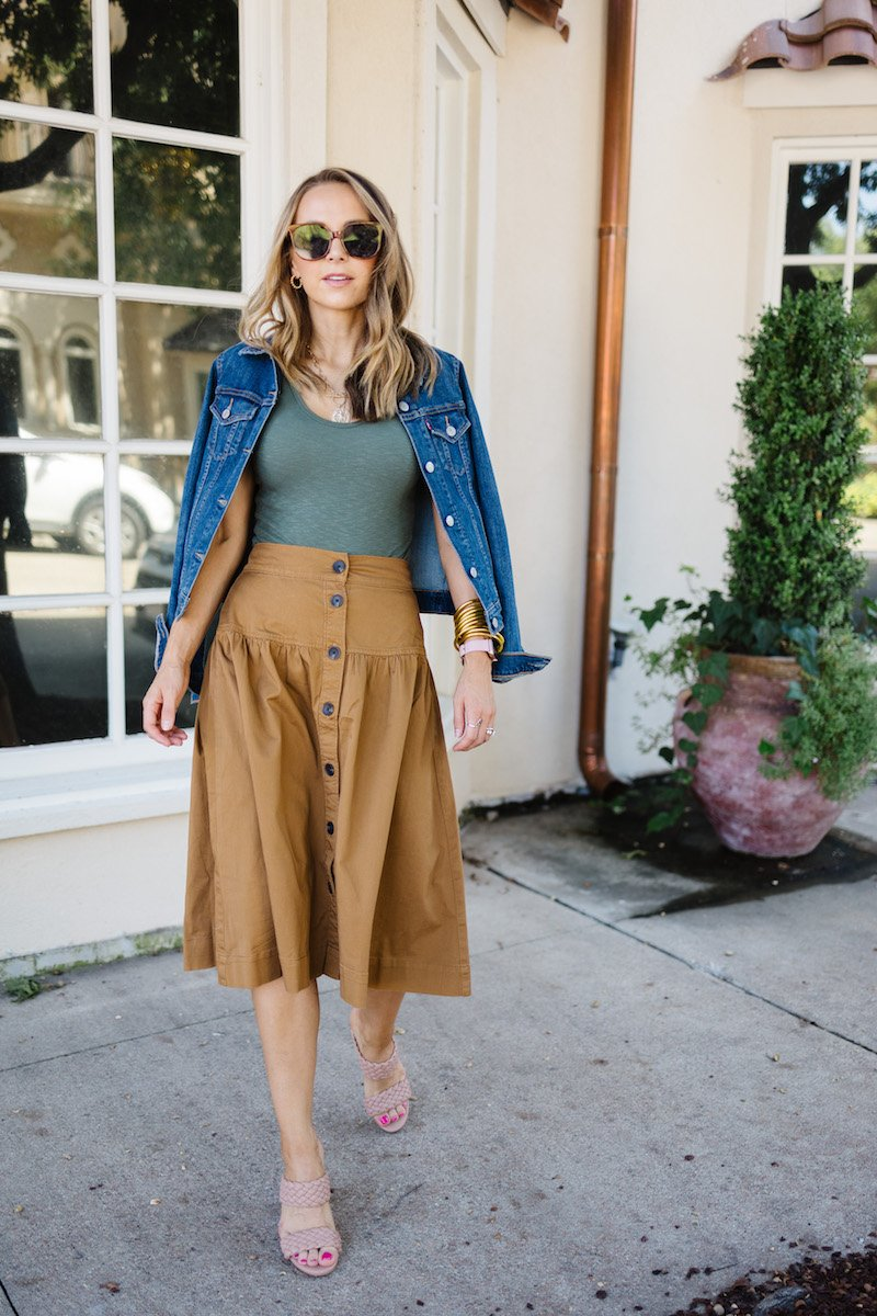 green bodysuit with brown skirt