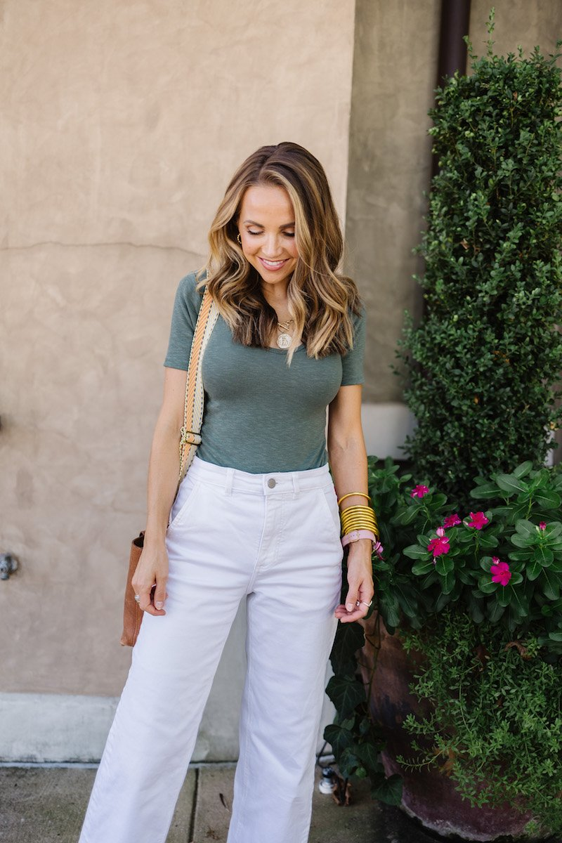 green bodysuit with white pants