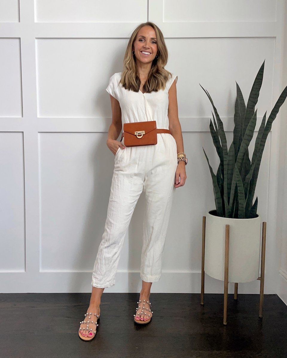 white jumpsuit with studded sandals