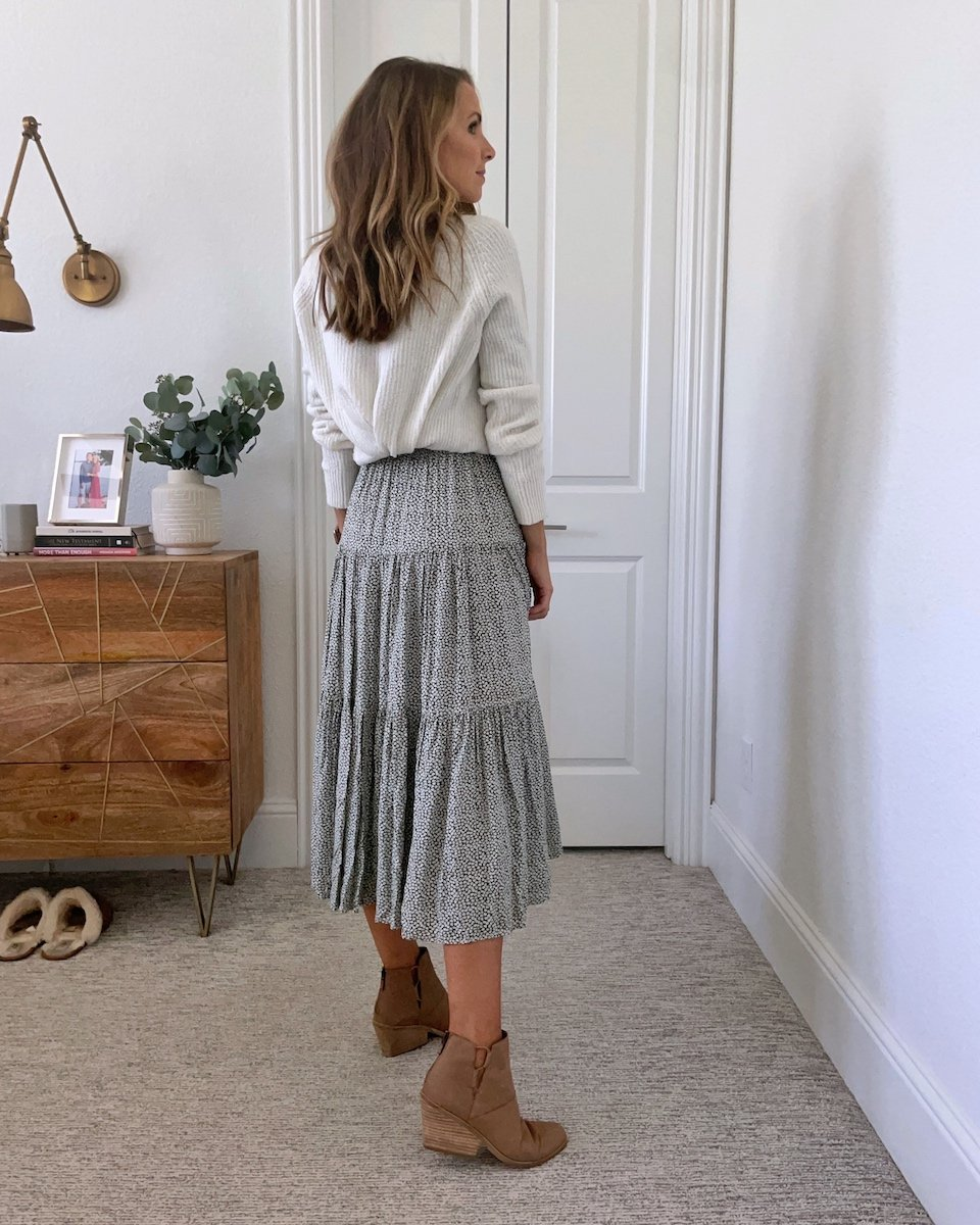 sweater tucked behind dress