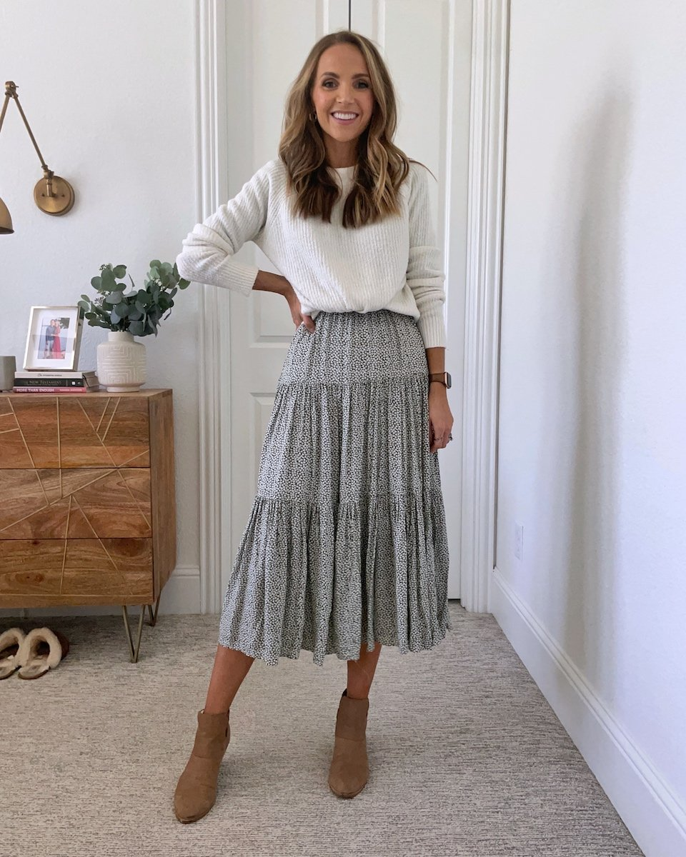 sweater tucked over dress